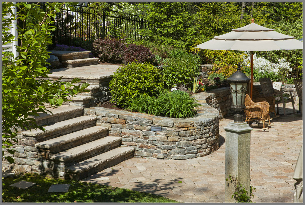 Back yard masonry by Artistic Outdoors
