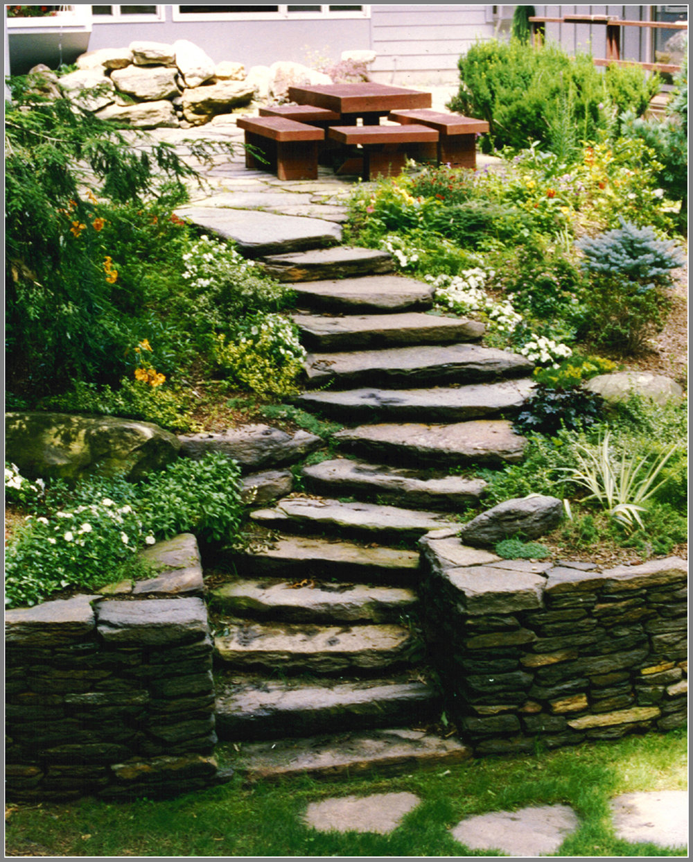 Rustic Stone wall and steps by Artistic Outdoors
