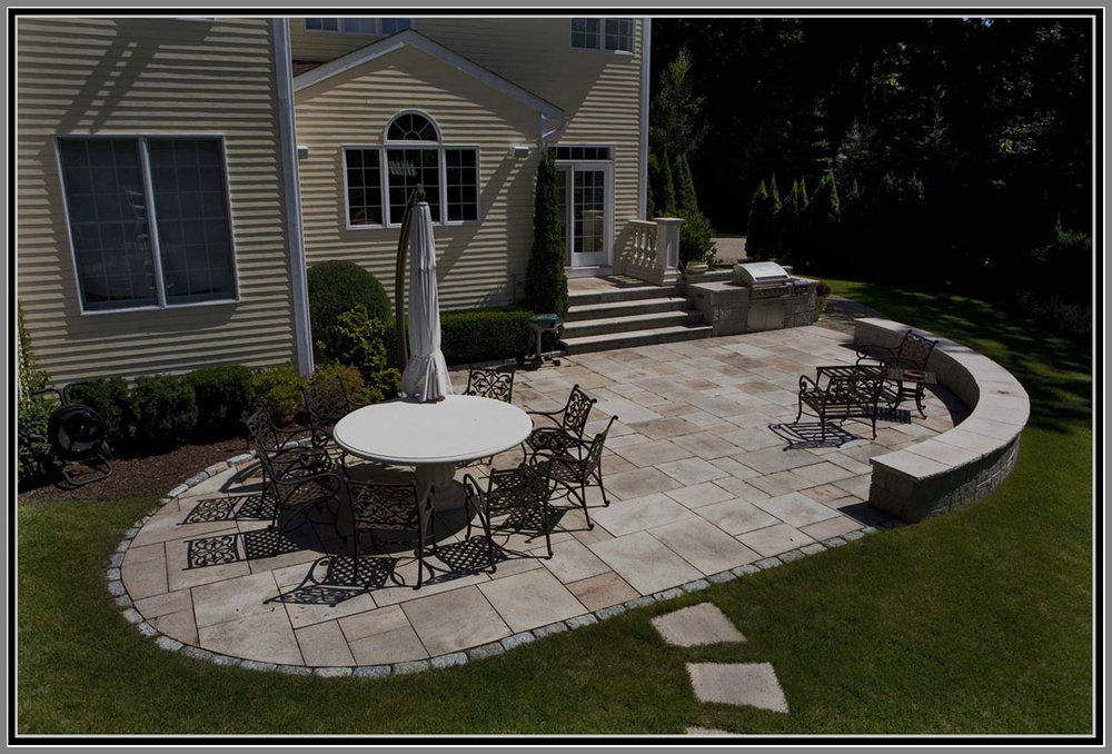 Granite patio and sitting stone wall