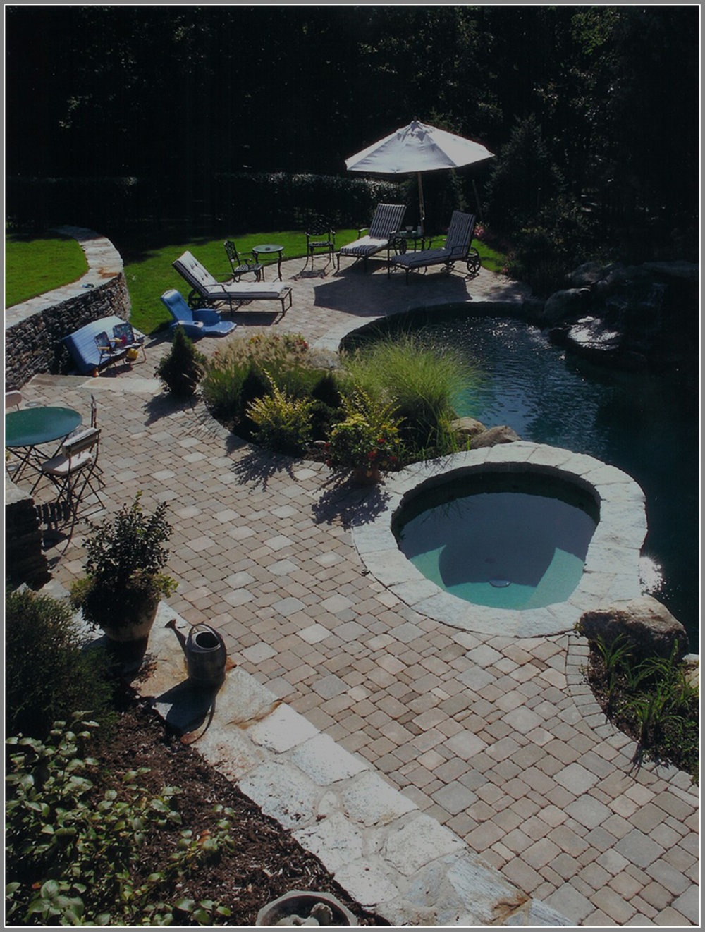 Concrete paver pool deck by Artistic outdoors