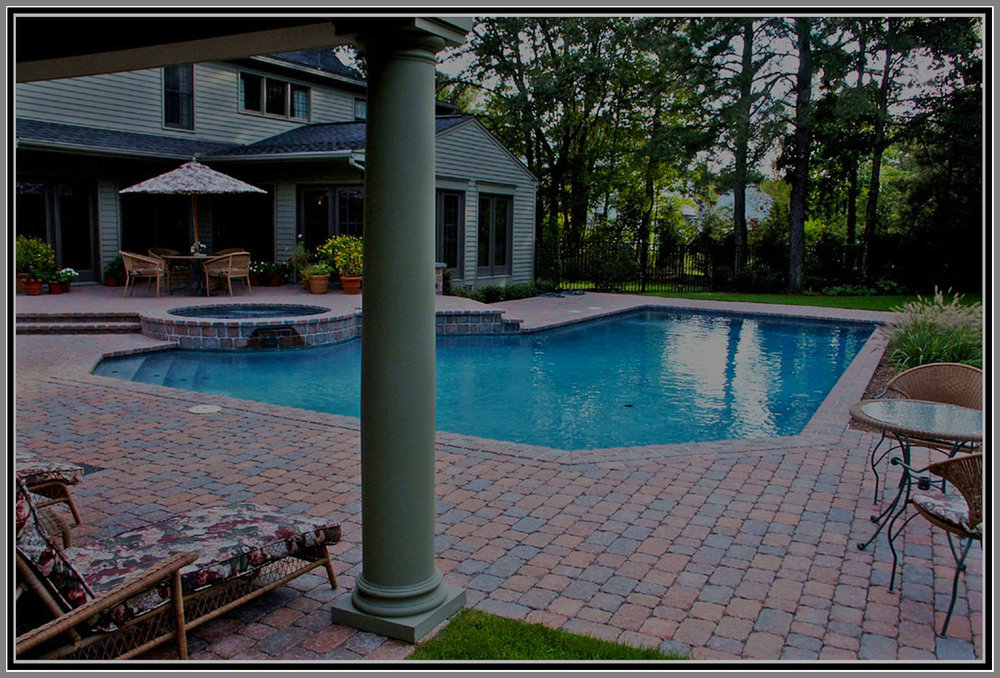 Concrete paver patio by Artistic Outdoors