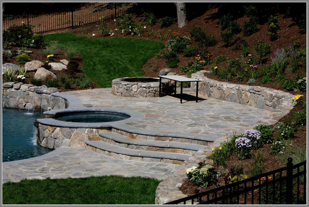 Flagstone pool deck and stone wall