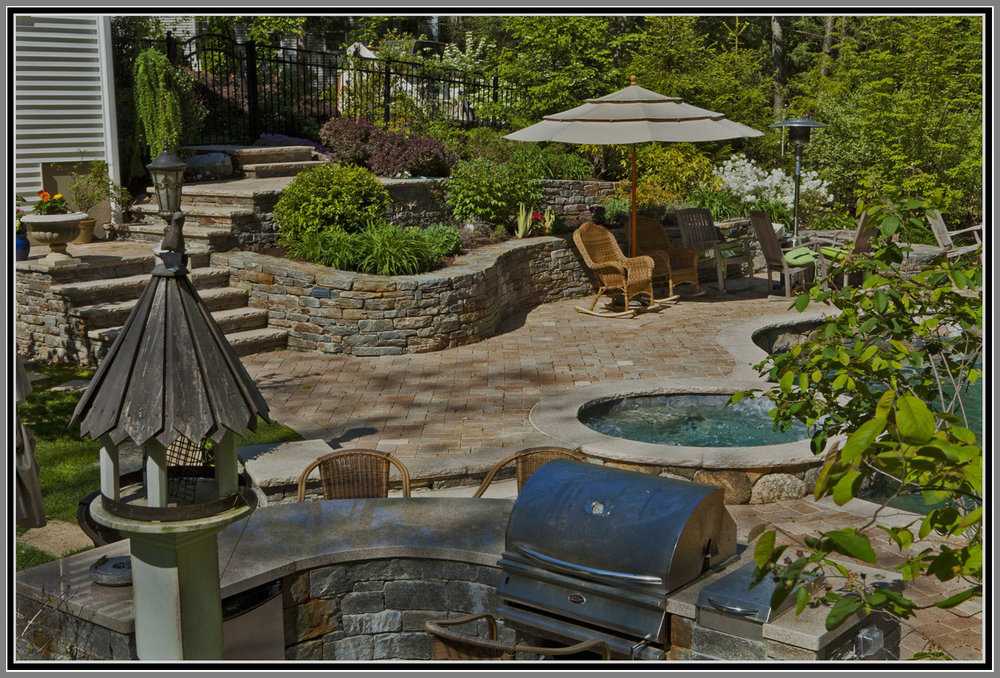 Outdoor kitchen and bar top by the pool