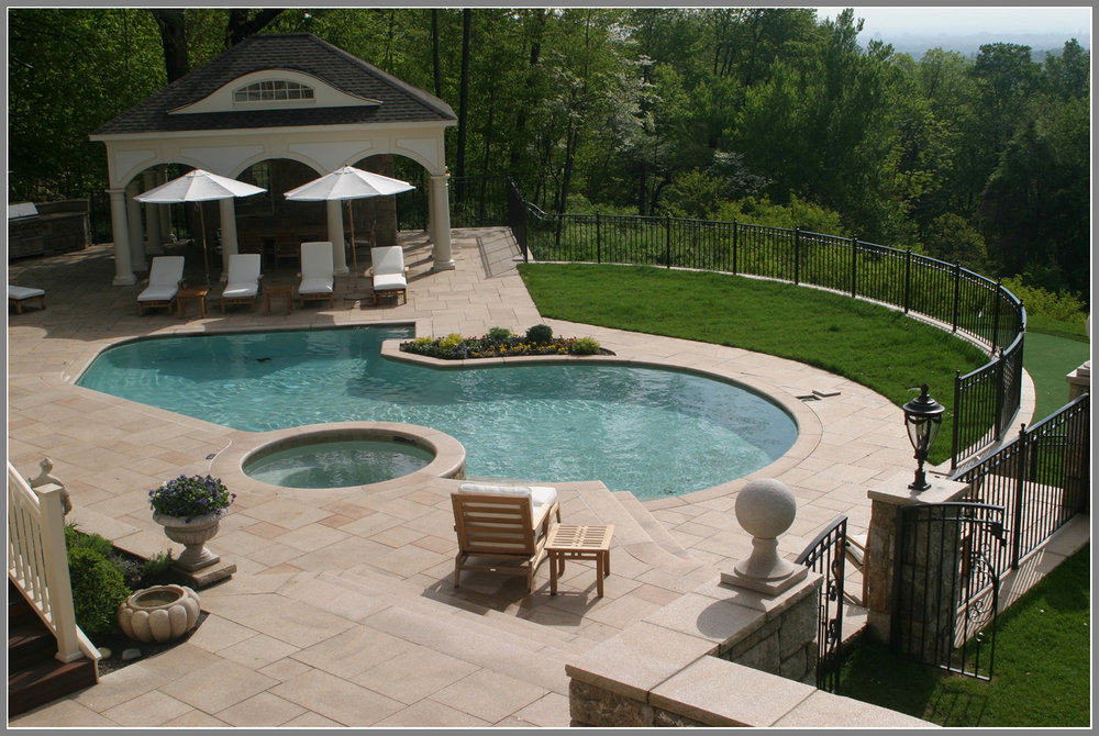 Swimming pool design and masonry by Artistic Outdoors