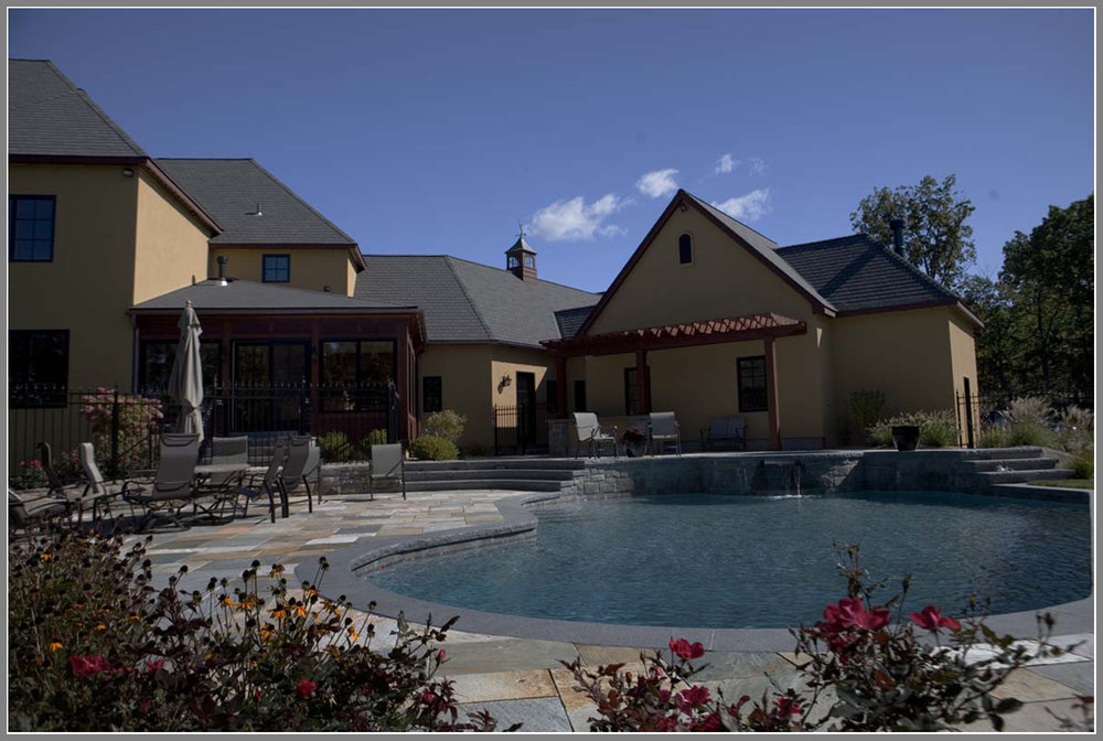 Swimming pool design with raised spa