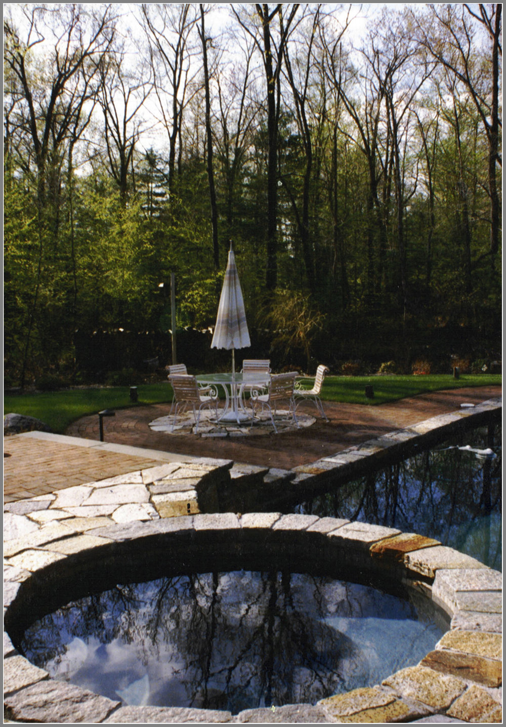 Swimming pool with granite coping and brick patio