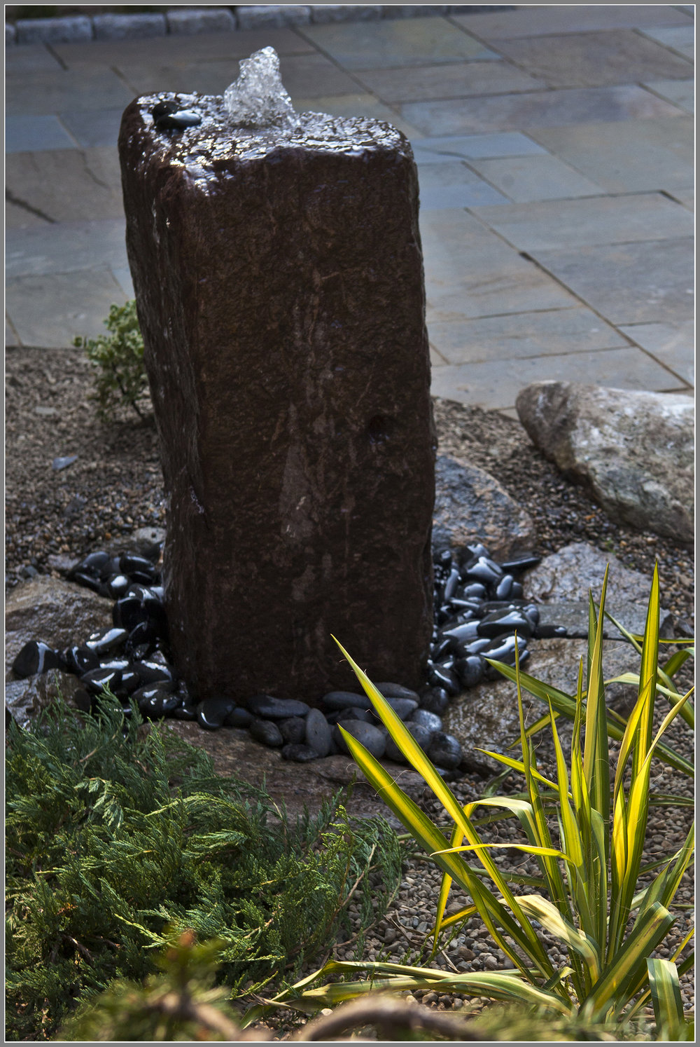 Natural stone water fountain by Artistic Outdoors