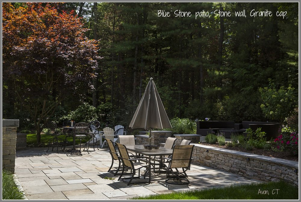 Blue stone patio and stone wall