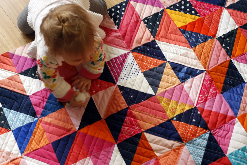 modern quilting on half square triangle blocks
