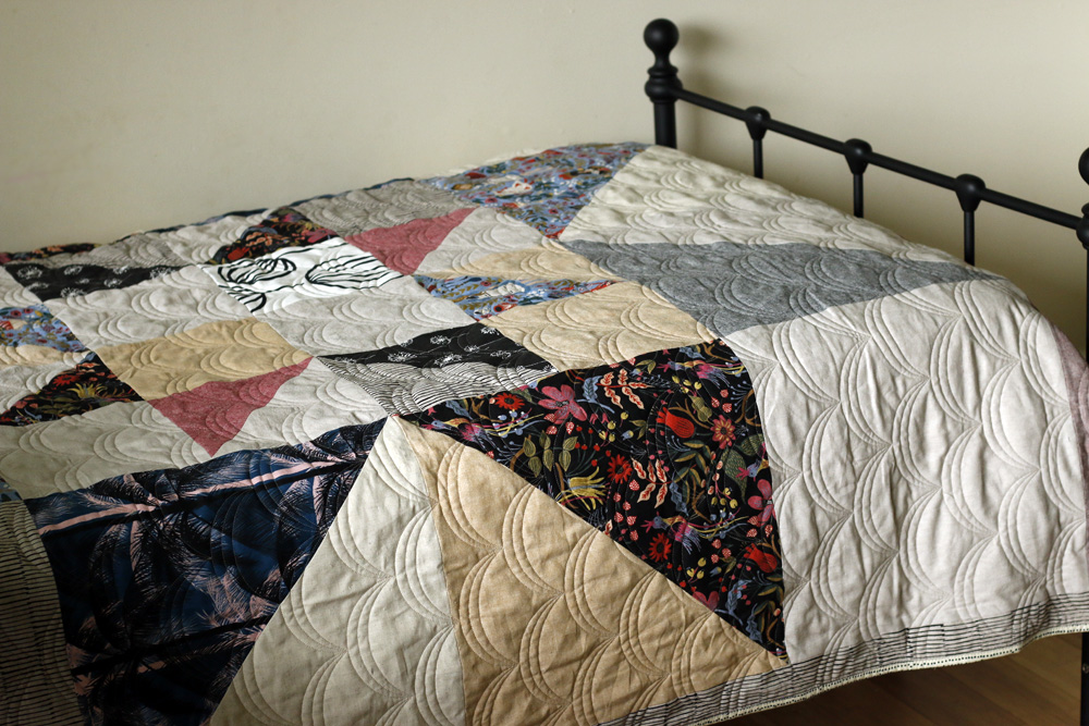 Double star quilt on twin bed