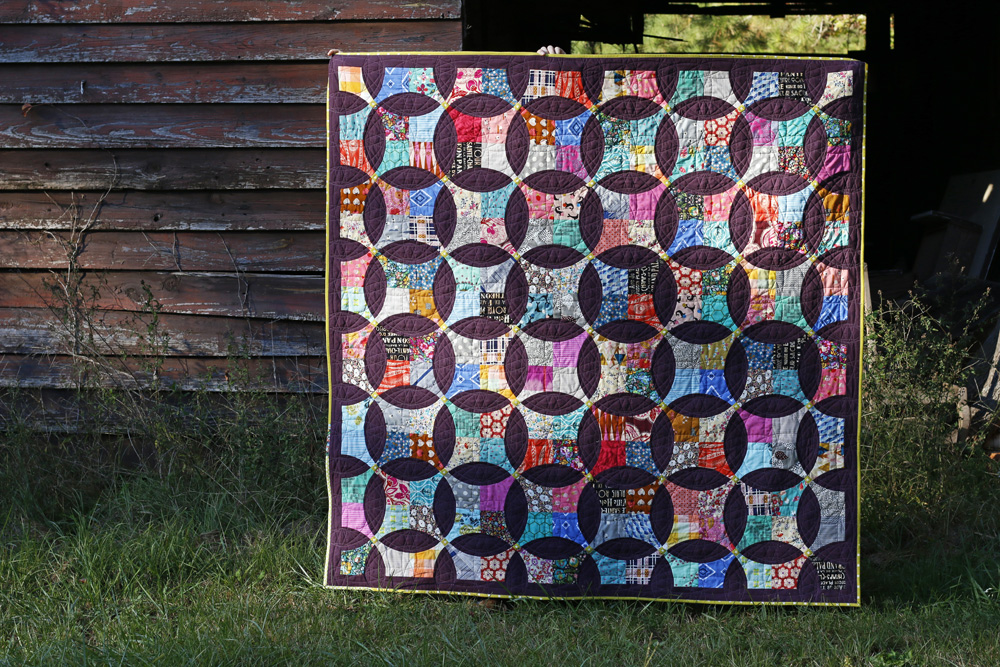 Plum Pudding flowering snowball quilt. Stitched in Color.jpg