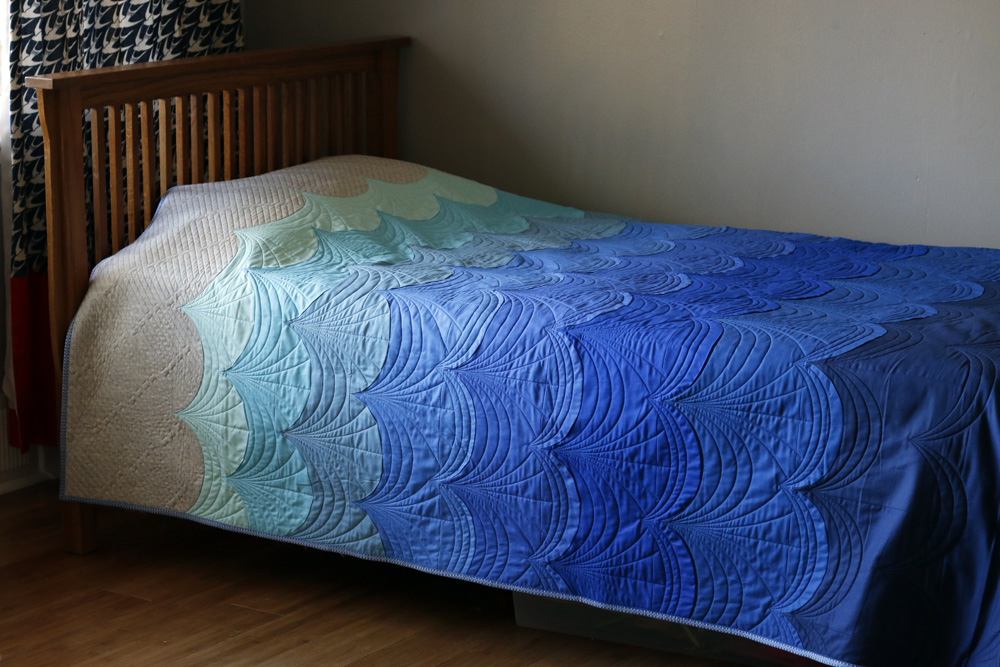 Custom quilted wave quilt. Stitched in Color.jpg