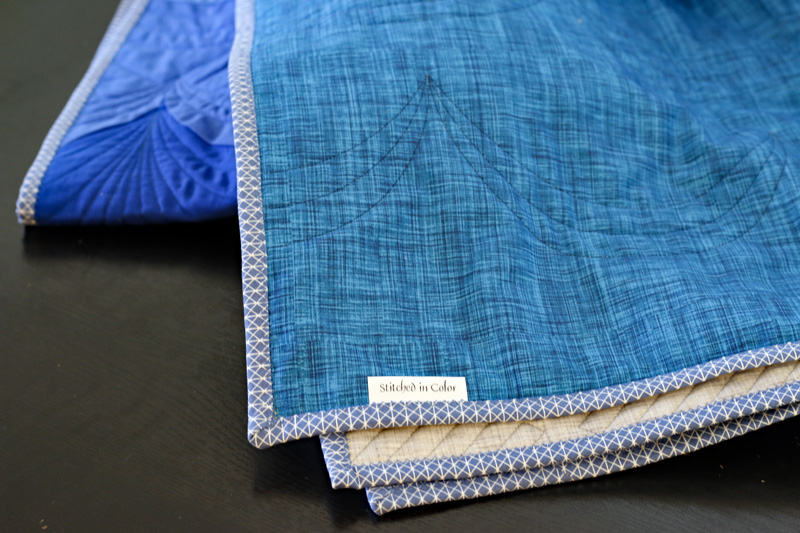 Color Weave quitl back. Stitched in Color.jpg