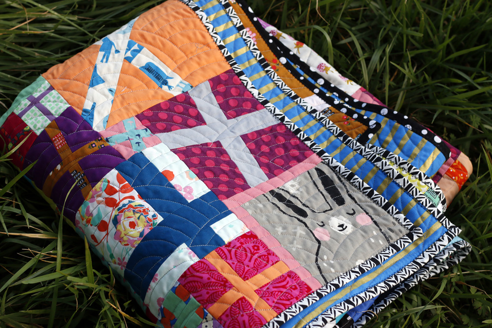 Bright, Colorful quilt. Stitched in Coloir.jpg