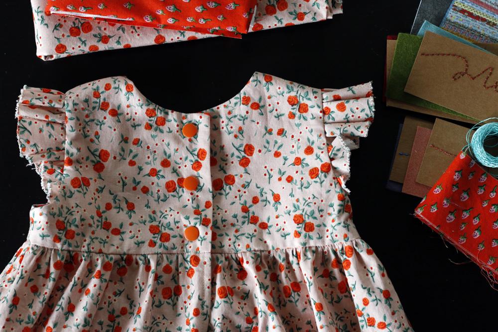 Snap closure geranium dress. Stitched in Color.jpg