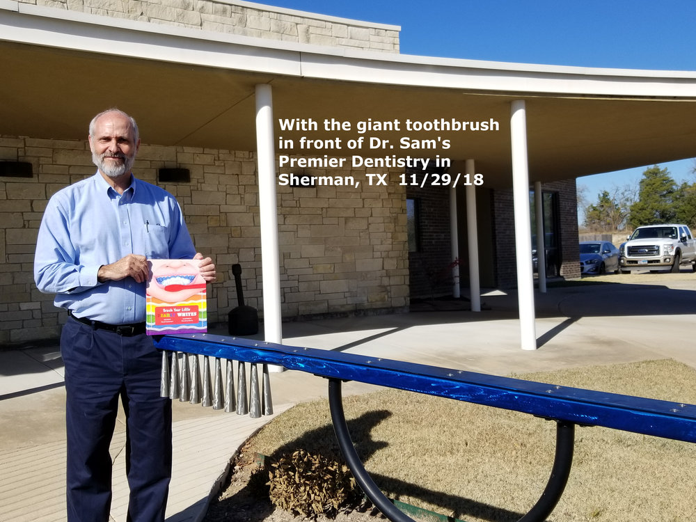 With Giant Toothbrush in Sherman.jpg