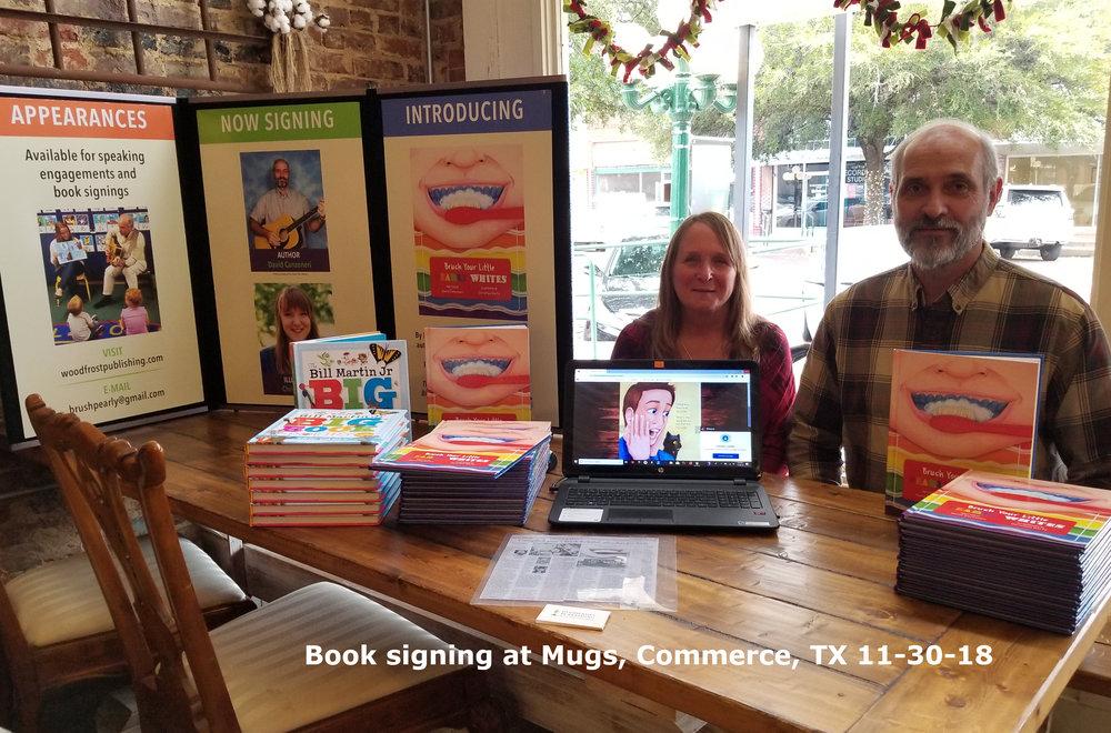 Mugs signing.jpg