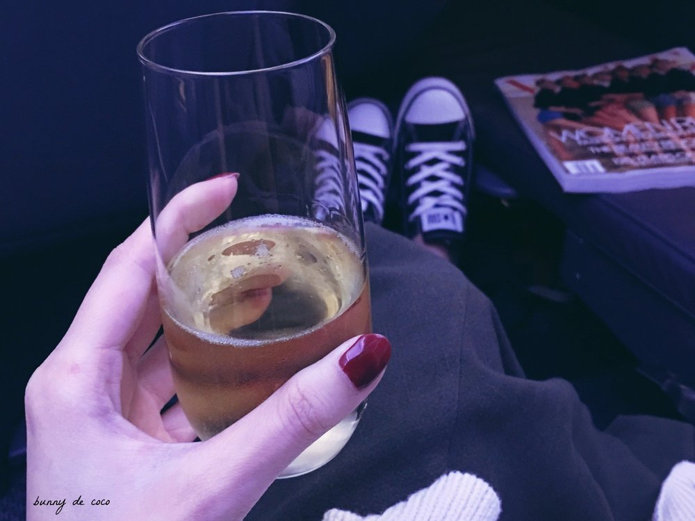 Champagne in hand. Ready for take-off.