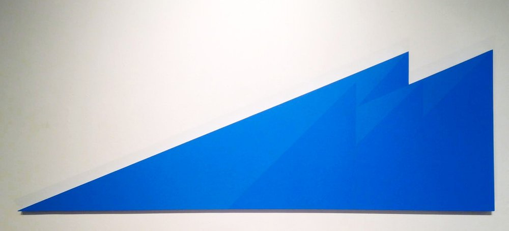 Blue Roofs , 2018  Acrylic on Wood, 24 x 72 inches