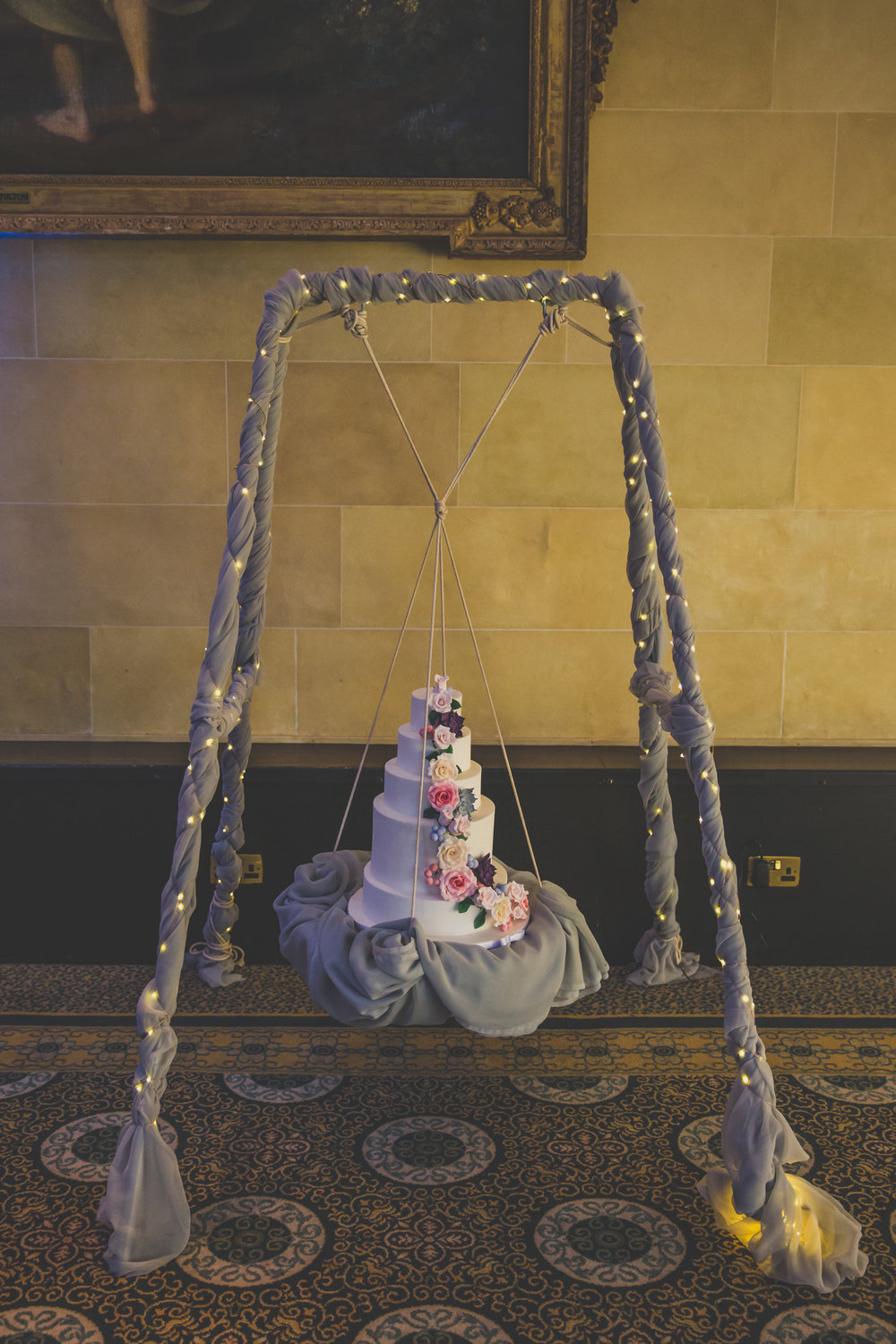 Bedfordshire wedding cake on a swing