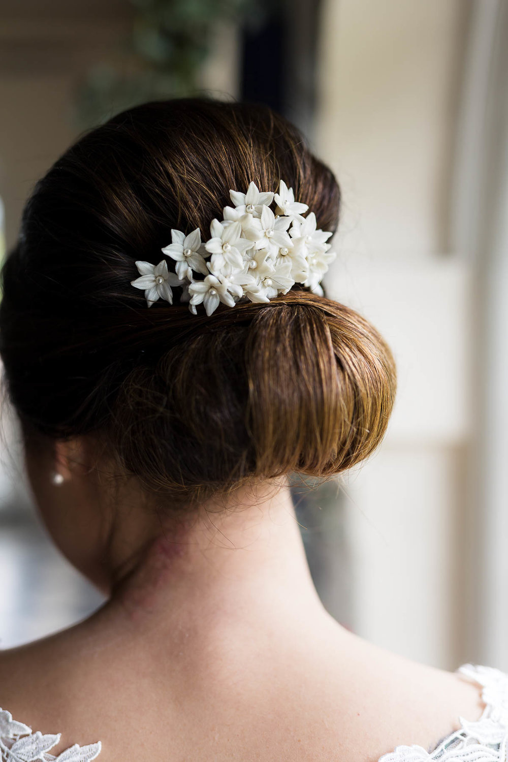 white floral brides hair piece bespoke design by Bedfordshire designer Rachel Louise bridal