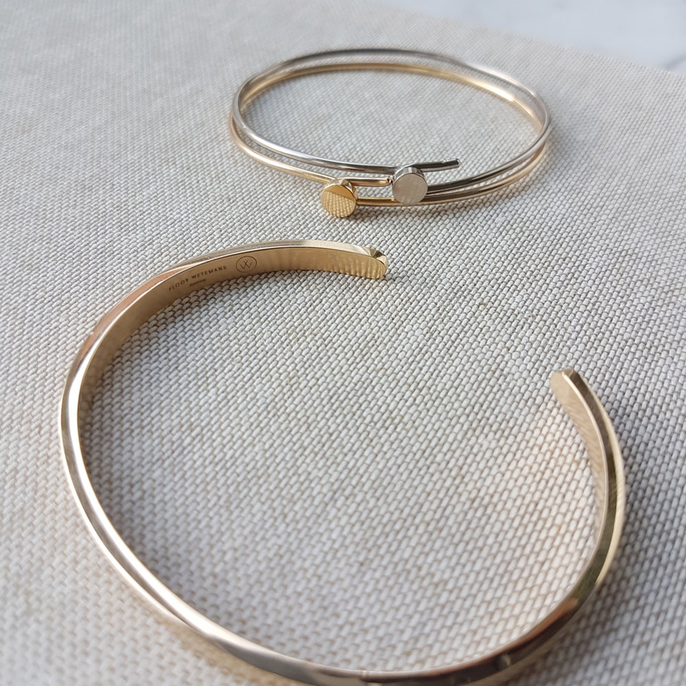 Different bracelets in 18k yellow and white gold