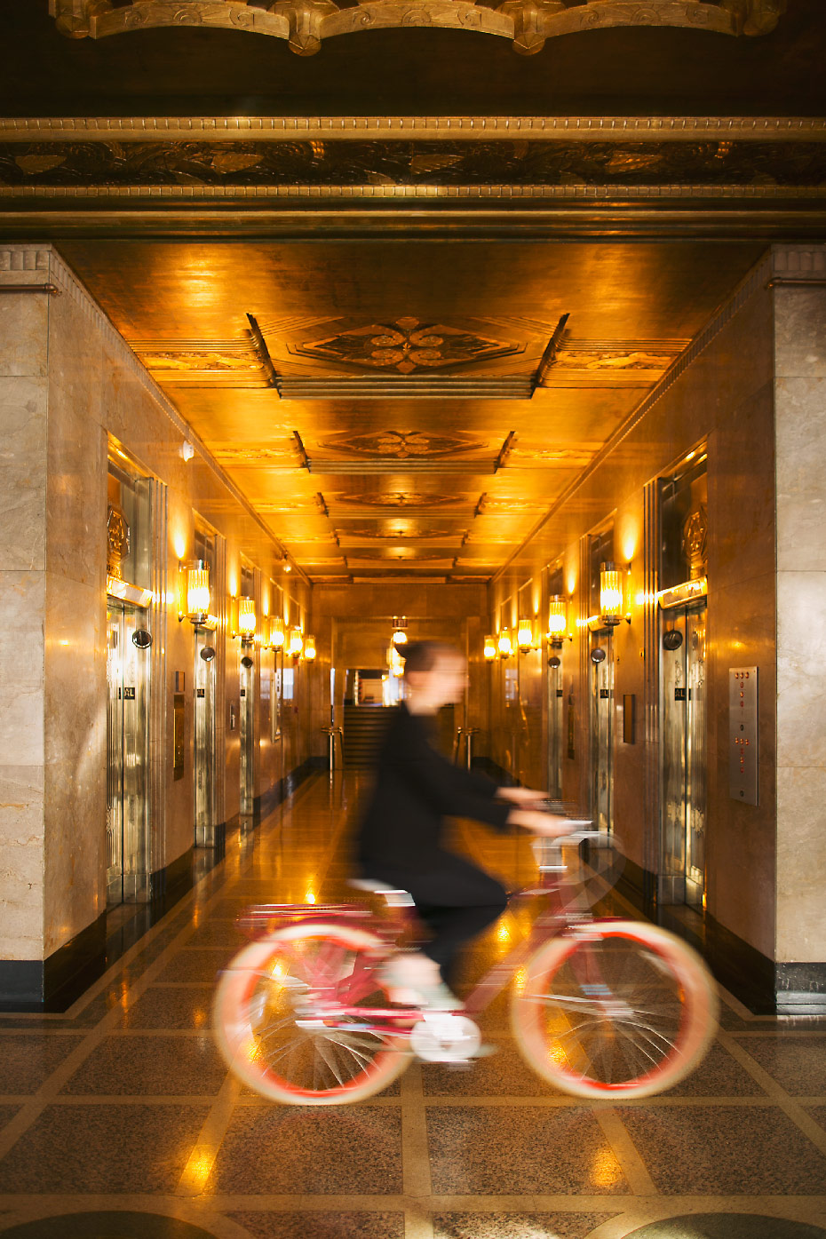 Stacey Van Berkel Photography I Cycling in the gilded lobby of the Kimpton Cardinal Hotel I Inspired the design of the Empire State Building I Winston-Salem, North Carolina