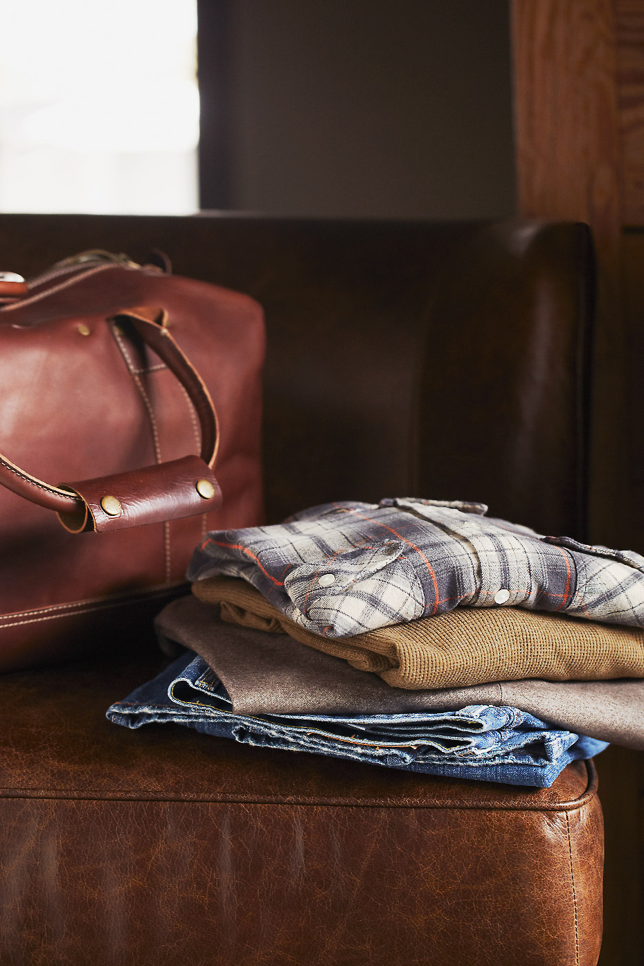 Stacey Van Berkel Photography I Gentlemen's Travel bag with clothing I Bernhardt Furniture