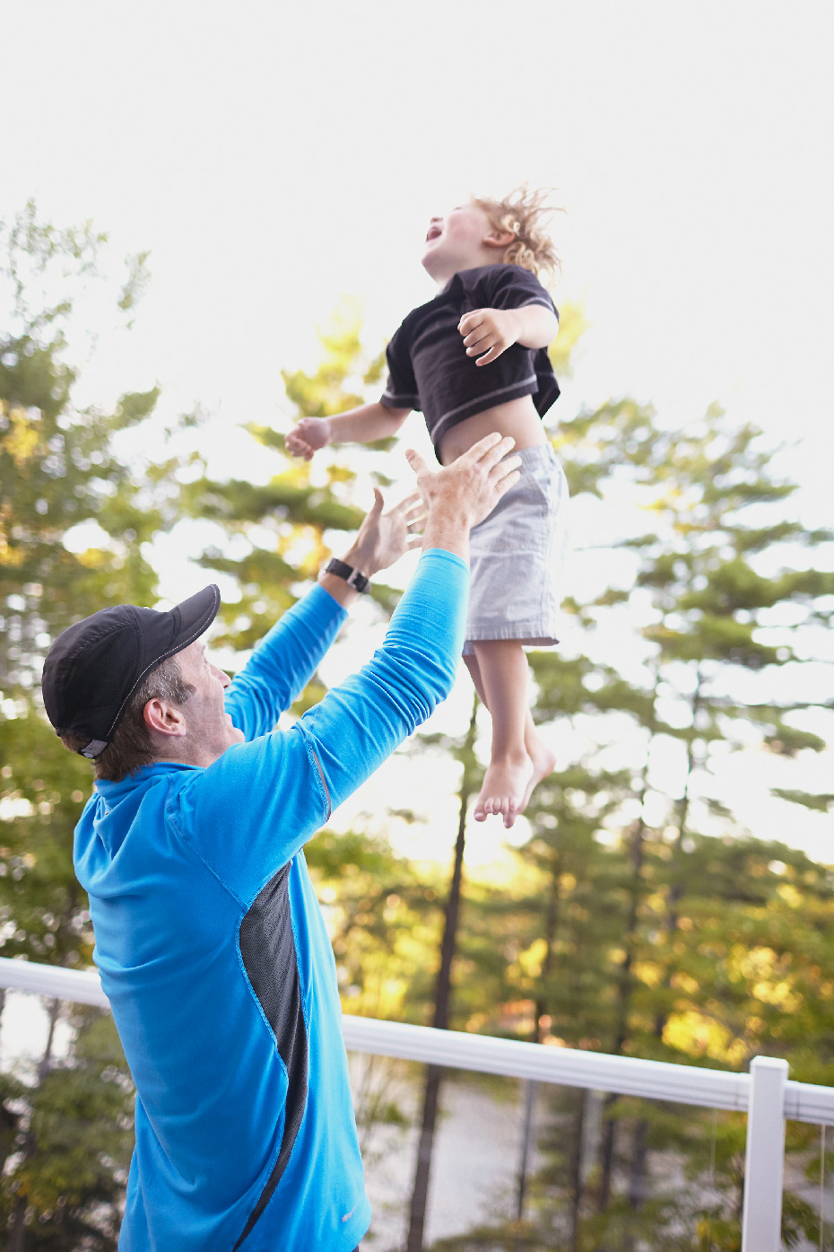 Stacey Van Berkel Photography I Father throwing his son in the air