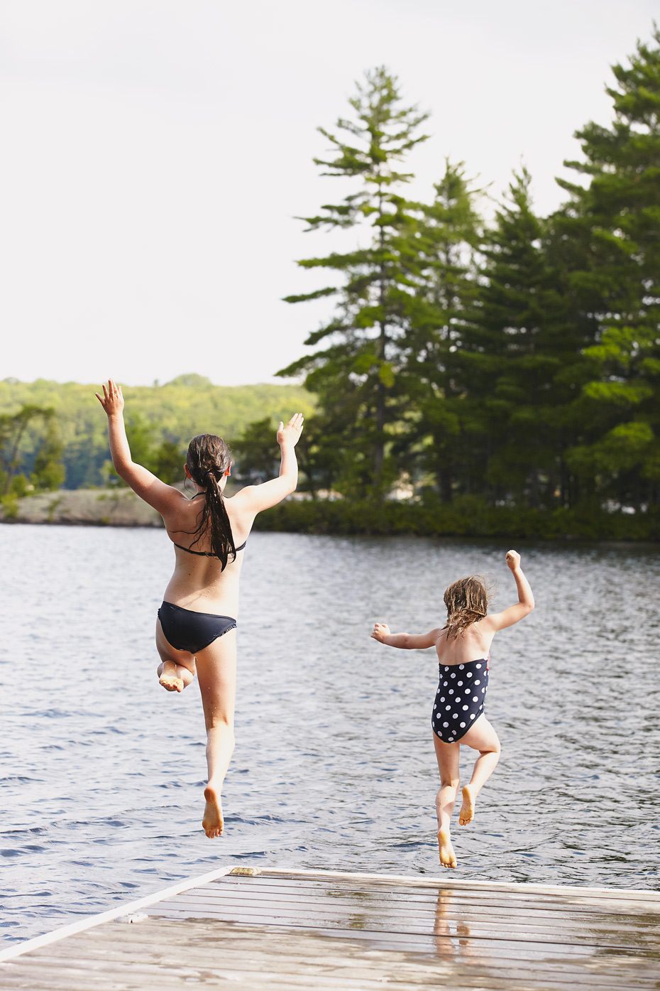 Stacey Van Berkel Photography I two young girls jumping off a dock I Muskoka, Ontario, Canada