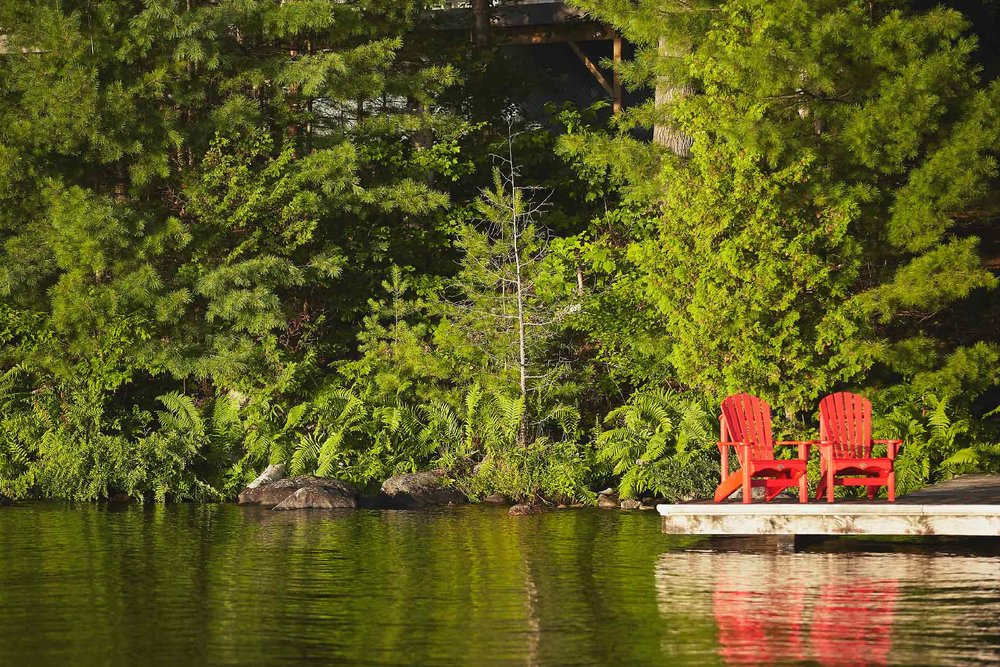 Stacey Van Berkel Photography I two red adirondack chairs on dock I Muskoka, Ontario, Canada