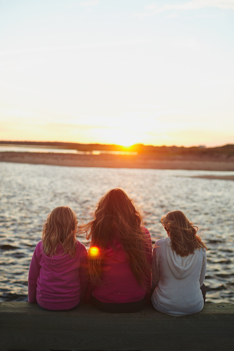 Stacey Van Berkel Photography I Three girls watching the sunset at Covehead Wharf I Prince Edward Island, Canada