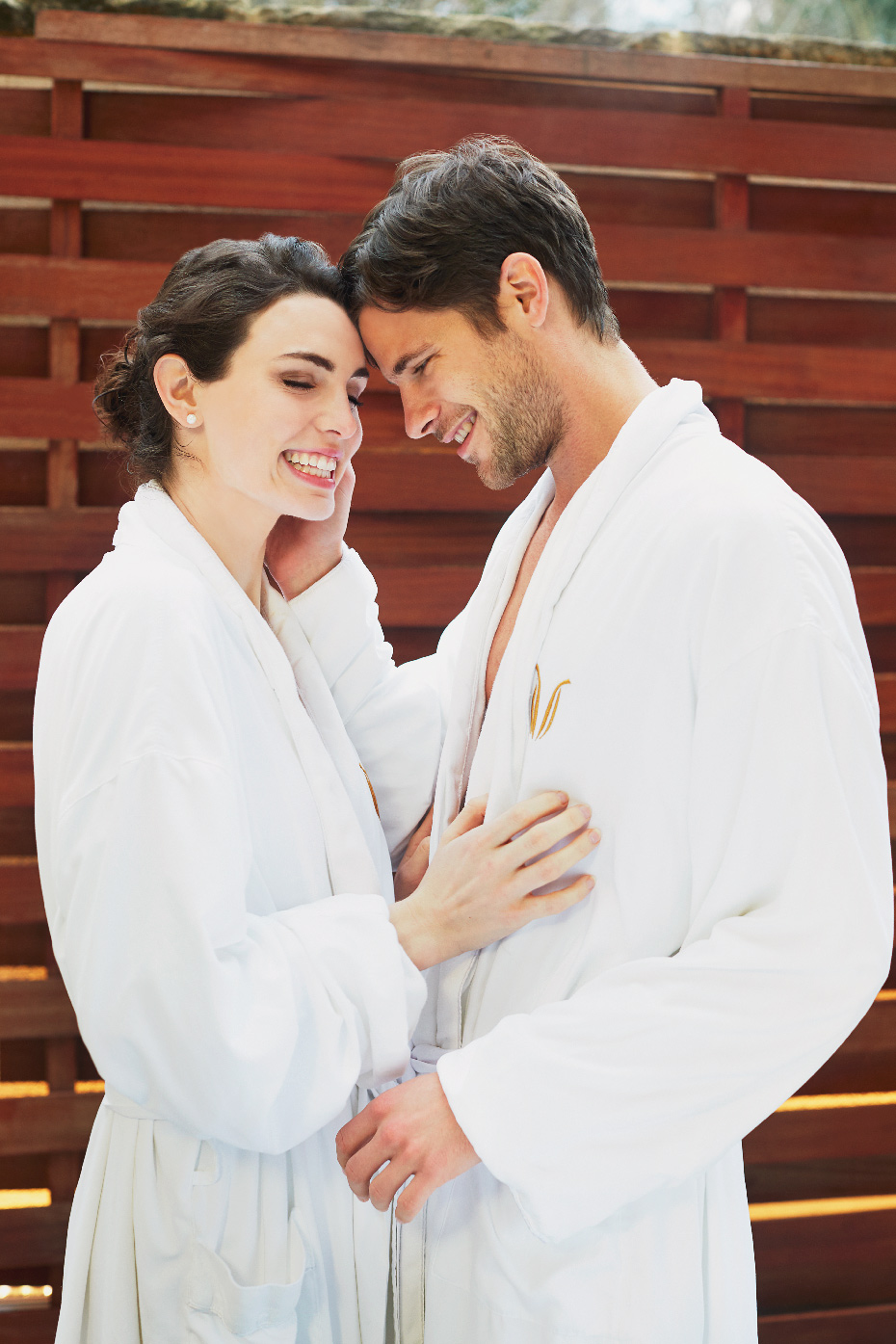 Stacey Van Berkel Photography I Young couple in white bathrobes hugging I The Umstead Hotel and Spa I Cary, North Carolina