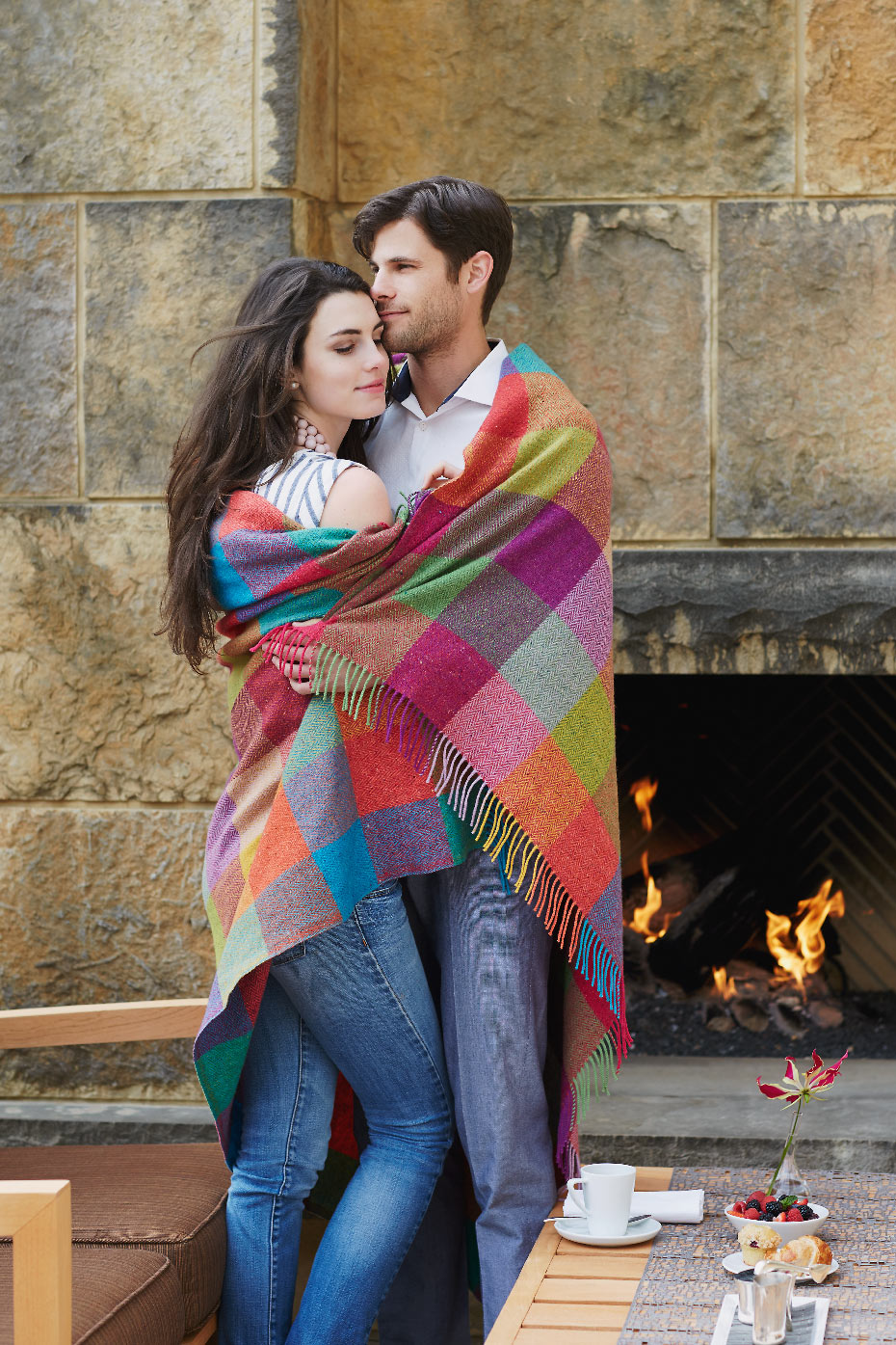 Stacey Van Berkel Photography I Young couple embracing by outdoor fire I Avoca Ireland blanket I The Umstead Hotel and Spa I Cary, North Carolina