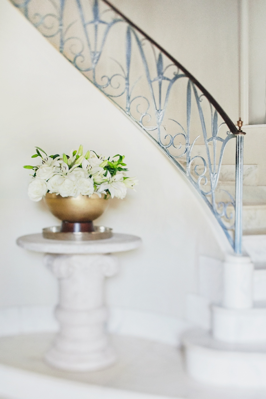 Stacey Van Berkel Photography I Elegant spiral staircase with flower arrangement I Bernhardt Furniture