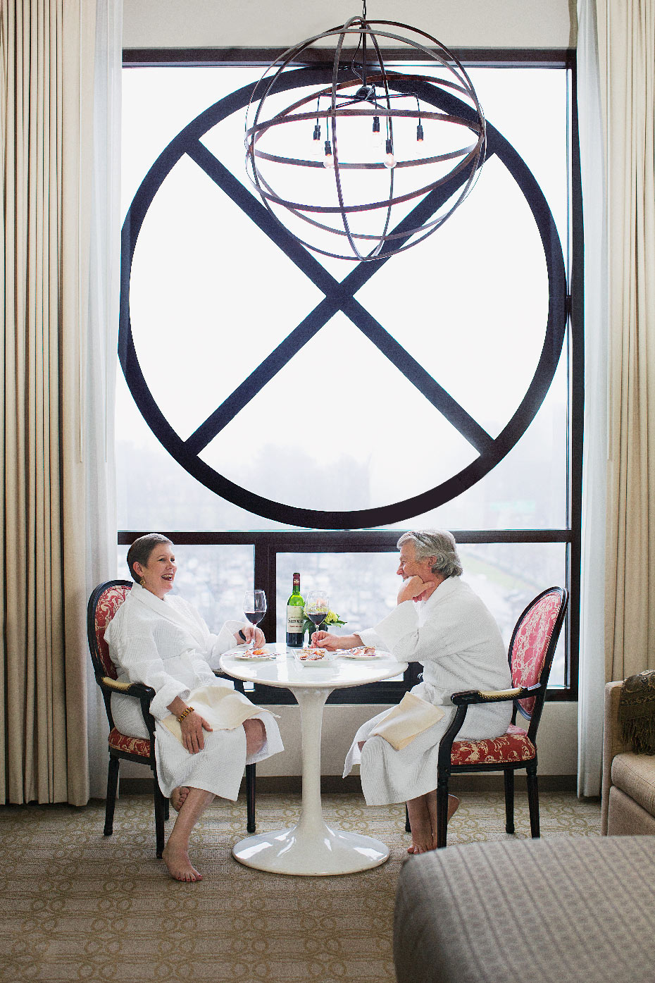 Stacey Van Berkel Photography I Dennis & Nancy Quaintence having wine in bathrobes I Proximity Hotel I Luxury living I
