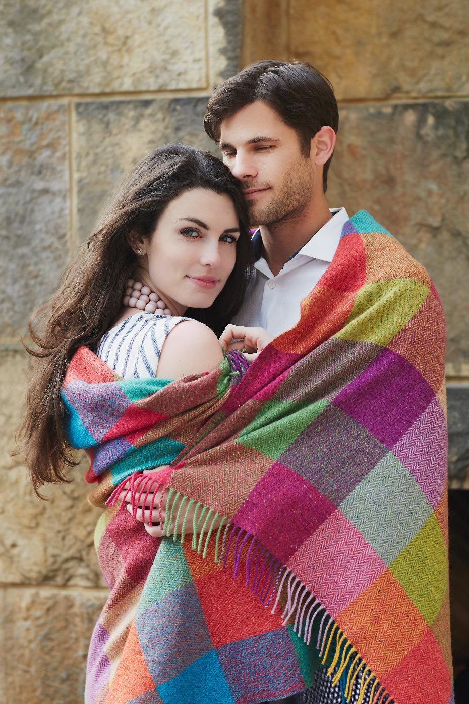 Stacey Van Berkel Photography I Couple embracing under Avoca Ireland wool blanket I The Umstead Hotel and Spa I Cary, North Carolina