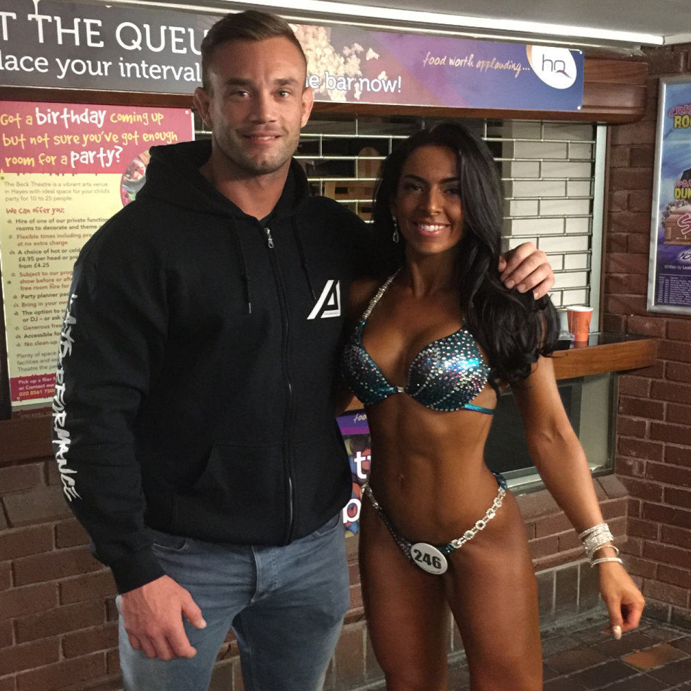 "HELEN PEEBLES   ""I came to Adam having not really had a structured diet before and was not tracking my macros. I had only been weight training for 8 months and decided I wanted to enter my first competition (two in one weekend actually).  The progress I made in the 14 week prep with Adam was incredible and I got into the best shape I had ever been in and placed in my first two competitions with some very tough competitors!   I was worried at first when I wasn't seeing results straight away, but I thankfully trusted Adam and the process. His extensive knowledge and experience shone through and he has gave me the extra confidence I needed in myself. Thank you again!"""