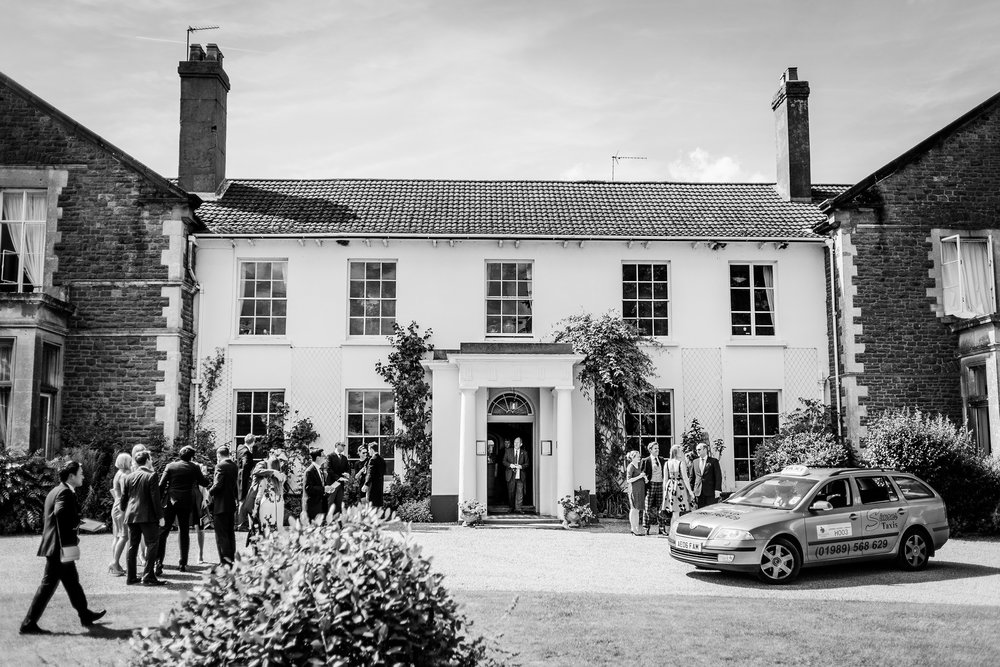 Guests arriving for a wedding at Glewstone Court