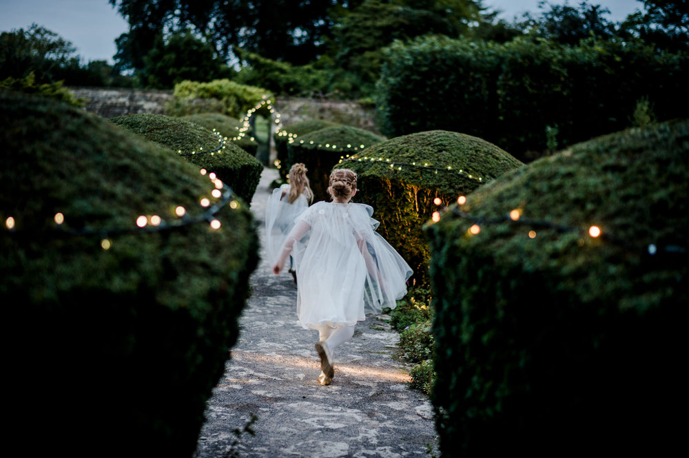 authentic photo of flowergirls running during dusk.jpg