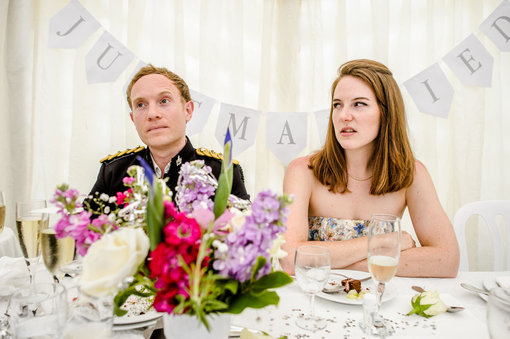 wedding photo of bride and groom during speeches.jpg