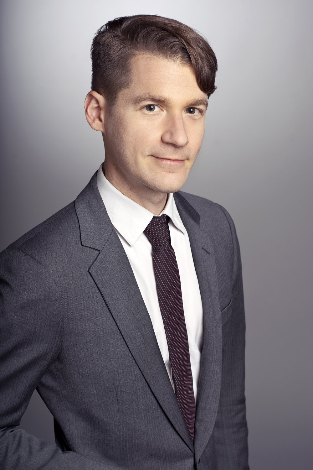 David Headshot Grey Suit Side Profile.jpg
