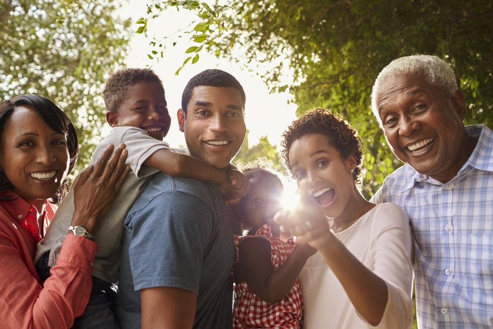 multi-generation-black-family-in-garden-look-to-PM8ENMZ.jpg