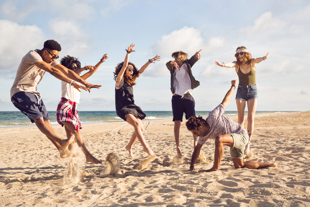happy-young-people-jumping-on-the-beach-PRB5EVX.jpg