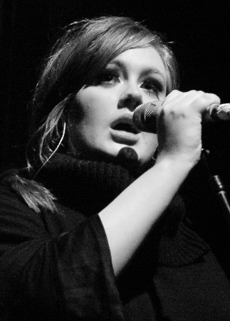 """Adele - Live 2009 (4) cropped"" by CHRISTOPHER MACSURAK. Licensed under CC BY 2.0 via Commons - https://commons.wikimedia.org/wiki/File:Adele_-_Live_2009_(4)_cropped.jpg#/media/File:Adele_-_Live_2009_(4)_cropped.jpg"