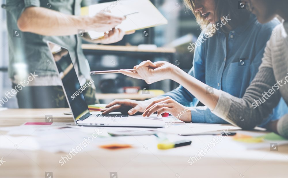stock-photo-team-job-photo-young-businessmans-crew-working-with-new-startup-project-in-modern-loft-generic-387274792.jpg