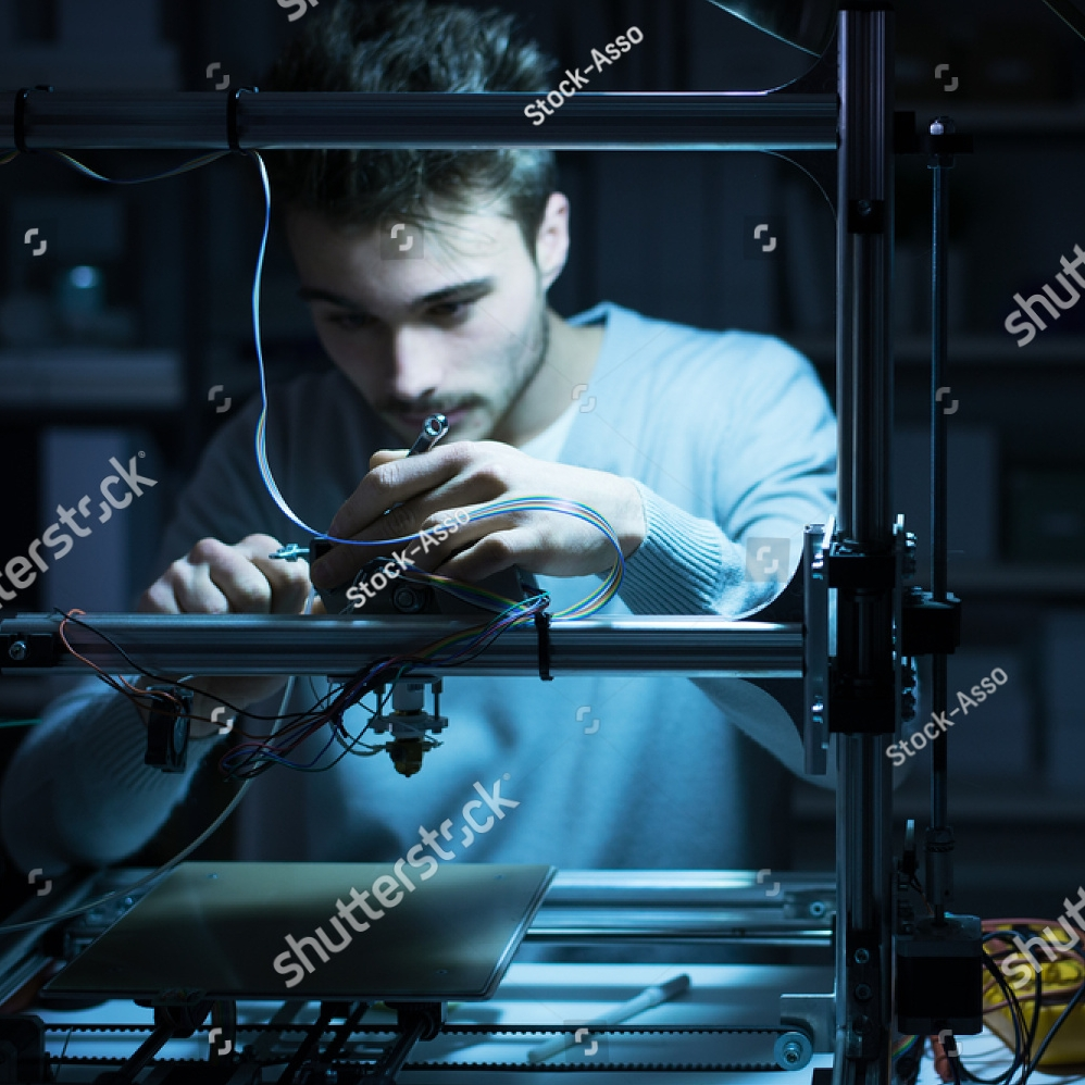 stock-photo-young-engineer-working-at-night-in-the-lab-he-is-adjusting-a-d-printer-s-components-technology-375131794.jpg