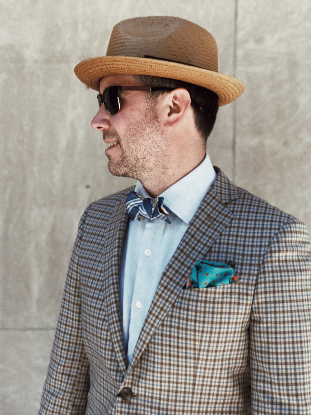 On Craig: Sunglasses: Shwood, Shirt: Peter Millar, Jacket: BluJacket, Bowtie: The QG, Pocket Square:  Seaward & Stern