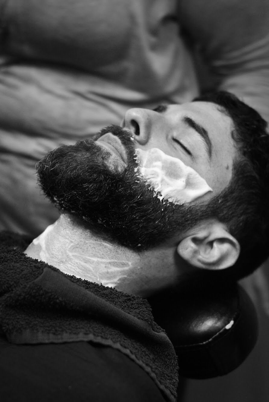 The Quinntessential Beard Trim includes a full shave of the cheeks and neck instead of us providing a straight razor outline of our basic service