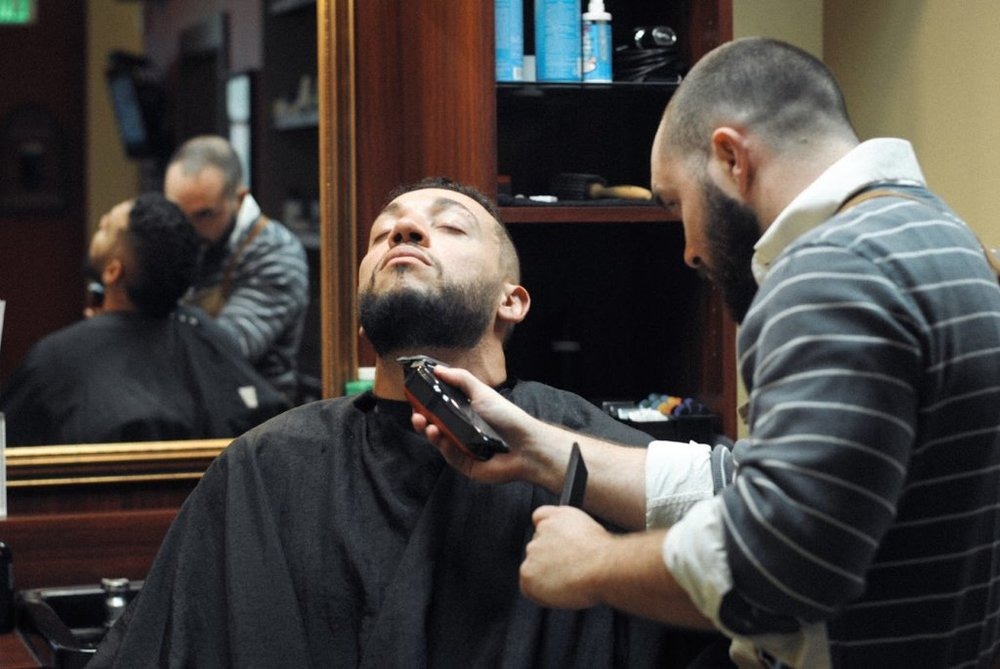 Finding the proper line to start and stop the beard as well as making it appear even are two of the most difficult jobs of our barbers.